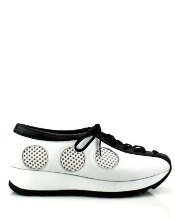 Sneakers en piel blanca y negra con cordones y plataforma